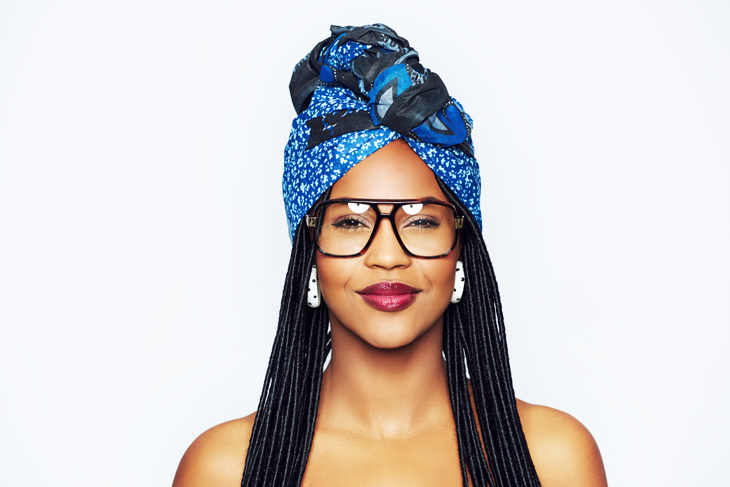 There is nothing worse than dealing with your hair while you're traveling. These travel hairstyles will help keep your hair under control. Try using a head scarf or getting braid done.